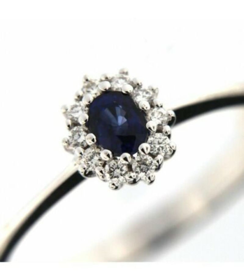 ring-washer-davite-amp-delucchi-aa028996-zf-with-blue-sapphire-and-contour-of-diamonds